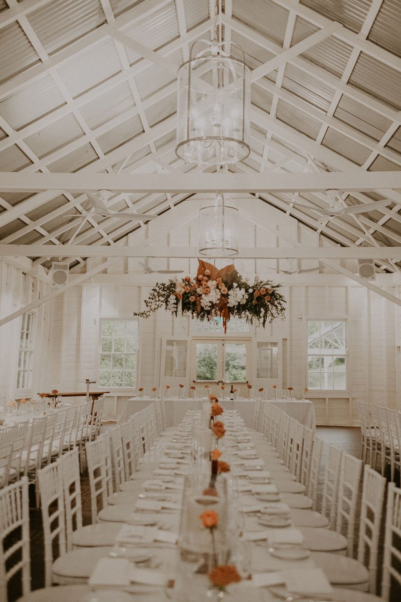 Large boho style hanging wedding flowers at Athol Hall